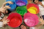 IOE - Colour Our Youth NYW2013 Paint Buckets Ready Pose
